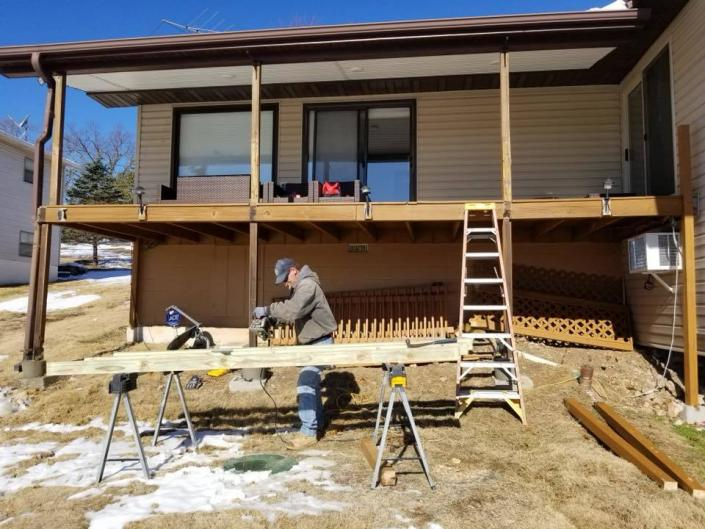 [Image: We offer professional deck building and porches with our construction services!]
